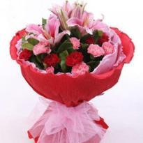 Red and Pink Carnations with Pink Lilies in Red Packing