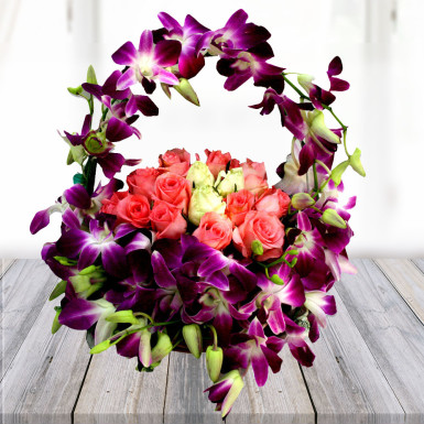 Buy Pink with Yellow roses with Orchids in a basket