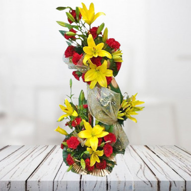 Buy 2 tier arrangement of Lilies