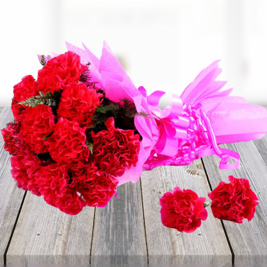 Buy Pink Carnations In Pink Packing