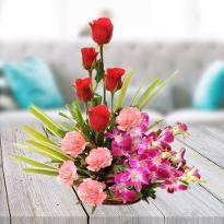 Basket of Orchids; Pink Carnation and Red Roses
