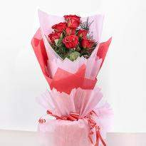 10 Red Roses in Paper Packing